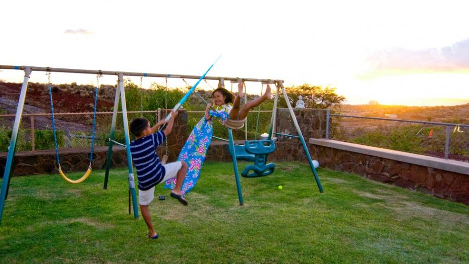 kids playing on swingset