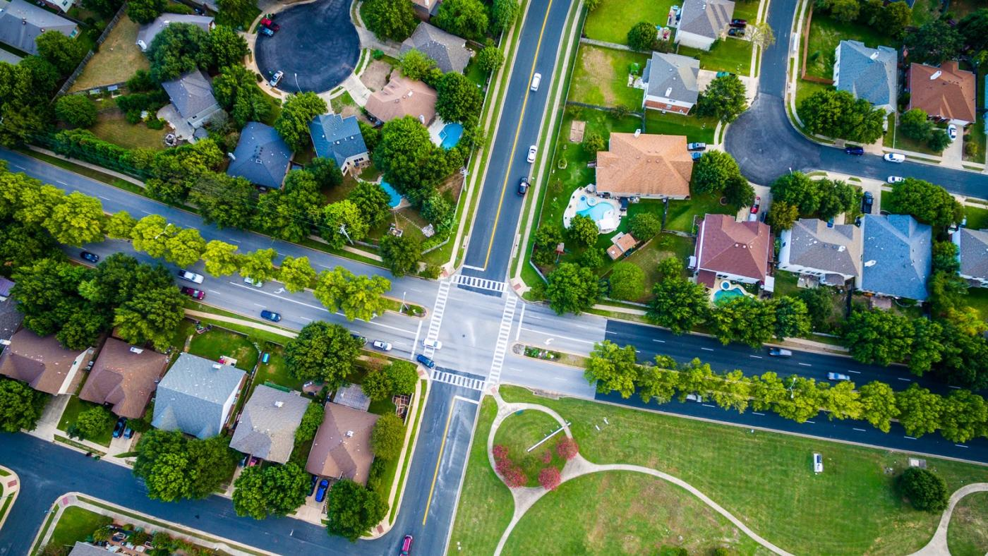 Top view from a crossroads on a residential area.